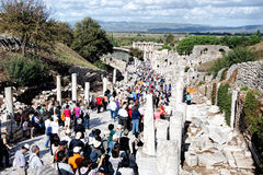Tourists Visit The Archaeological Ruins Of The Ionian City Of Ephesus, Turkey Royalty Free Stock Images