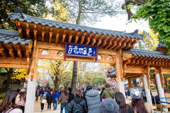 Tourists visit the traditional Korean cottages on Nami Island Royalty Free Stock Images