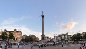 Tourists visit Trafalgar Square in London Royalty Free Stock Photo