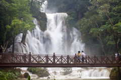 Tourists visit a waterfall Royalty Free Stock Images