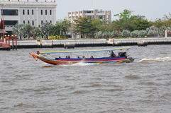 Tourists visiting Bangkok by boat on the jaopraya river. Near Wat Arun Bangkok stock photos
