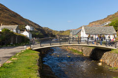 Tourists visiting Boscastle North Cornwall England UK between Bude and Tintagel on sunny blue sky day Stock Photos