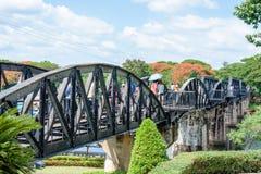 Tourists visiting the bridge over River Kwai in Kanchanaburi, Thailand.The bridge is famous. Kanchanaburi, Thailand - May 23, 2014: Tourists visiting the bridge Stock Photo