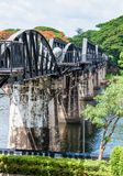 Tourists visiting the bridge over River Kwai in Kanchanaburi, Thailand.The bridge is famous Royalty Free Stock Photography
