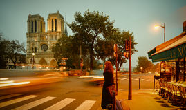 Tourists visiting the Cathedrale Notre Dame de Paris is a most famous cathedral 1163 - 1345 on the eastern half of the Cite Isla Stock Image