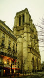Tourists visiting the Cathedrale Notre Dame de Paris is a most famous cathedral 1163 - 1345 on the eastern half of the Cite Isla Stock Photos