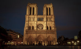 Tourists visiting the Cathedrale Notre Dame de Paris is a most famous cathedral 1163 - 1345 on the eastern half of the Cite Isla. FRANCE. PARIS - OCTOBER Royalty Free Stock Images