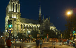 Tourists visiting the Cathedrale Notre Dame de Paris is a most famous cathedral 1163 - 1345 on the eastern half of the Cite Isla. FRANCE. PARIS - OCTOBER Stock Images
