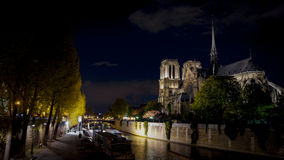 Tourists visiting the Cathedrale Notre Dame de Paris is a most famous cathedral 1163 - 1345 on the eastern half of the Cite Isla. FRANCE. PARIS - OCTOBER Stock Image