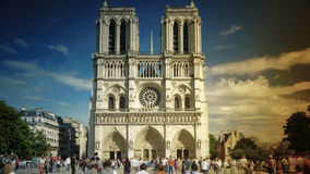 Tourists visiting the Cathedrale Notre Dame de Paris is a most famous cathedral 1163 - 1345 on the eastern half of the Cite Isla. FRANCE. PARIS - OCTOBER Stock Photo