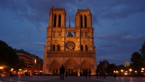 Tourists visiting the Cathedrale Notre Dame de Paris is a most famous cathedral 1163 - 1345 on the eastern half of the Cite Isla. FRANCE. PARIS - OCTOBER Royalty Free Stock Photography