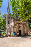 Tourists visiting the Chapel in the Regaleira Palace and Gardens. Sintra, Portugal - July, 2015: Tourists visiting the Chapel in the Regaleira Palace and Royalty Free Stock Photo