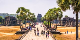 Tourists visiting complex Angkor Wat, Siem Reap province, Cambodia. stock photos