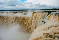 Tourists visiting the Devil s throat waterfall in the Iguazu Falls, one of the seven natural wonders of the world. Missions,. Argentina. UNESCO World Heritage royalty free stock images