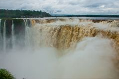 Tourists visiting the Devil s throat waterfall in the Iguazu Falls, one of the seven natural wonders of the world. Missions,. Argentina. UNESCO World Heritage stock image