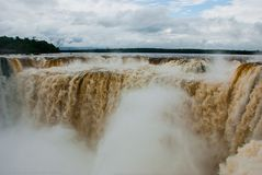 Tourists visiting the Devil s throat waterfall in the Iguazu Falls, one of the seven natural wonders of the world. Missions,. Argentina. UNESCO World Heritage stock photography