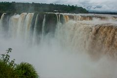 Tourists visiting the Devil s throat waterfall in the Iguazu Falls, one of the seven natural wonders of the world. Missions,. Argentina. UNESCO World Heritage royalty free stock photography