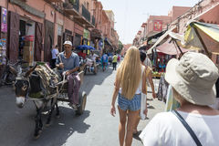 Tourists visiting Djemaa el Fna - market place in Marrakesh's medina quarter on 24 August 2014 in Marrakesh, Morocco. Stock Photography