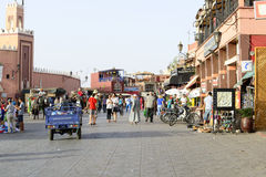 Tourists visiting Djemaa el Fna - market place in Marrakesh's medina quarter on 24 August 2014 in Marrakesh, Morocco. Royalty Free Stock Photo