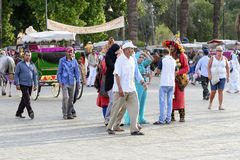 Tourists visiting Djemaa el Fna - market place in Marrakesh's medina quarter on 24 August 2014 in Marrakesh, Morocco. Royalty Free Stock Image