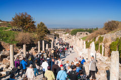 Tourists visiting Ephesus. Tourists visiting famous and historical Celsus Library in ancient Ephesus, this is curetes street which leads to Celsus Library Stock Images
