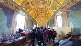 Tourists visiting the famous Gallery of Maps in the Vatican Museum stock video footage