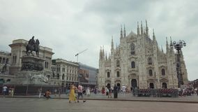 Tourists visiting the famous landmark cathedral Duomo at daytime. Milano, Italy - August 5, 2019: Tourists visiting the famous landmark cathedral Duomo at stock footage