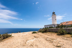 Tourists visiting Formentera La Mota lighthouse Royalty Free Stock Photo