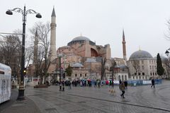 Tourists visiting the Hagia Sophia in front of Sultan Ahmed Park. ISTANBUL,TURKEY - DEC 29 : Tourists visiting the Hagia Sophia in front of Sultan Ahmed Park on stock photos