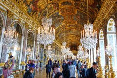 Tourists visiting the Hall of Mirrors in Versailles, France. VERSAILLES, FRANCE - SEPTEMBER 17, 2016: The Hall of Mirrors Galerie des Glaces is one of Versailles royalty free stock photo