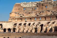 Tourists visiting inside part of  Colosseum in city of Rome, Italy. ROME, ITALY - JUNE 24, 2017: Tourists visiting inside part of  Colosseum in city of Rome Stock Photography