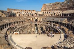 Tourists visiting inside part of Colosseum in city of Rome, Italy. ROME, ITALY - JUNE 24, 2017: Tourists visiting inside part of  Colosseum in city of Rome Royalty Free Stock Image