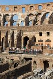 Tourists visiting inside part of  Colosseum in city of Rome, Italy. ROME, ITALY - JUNE 24, 2017: Tourists visiting inside part of  Colosseum in city of Rome Stock Image