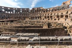 Tourists visiting inside part of Colosseum in city of Rome, Italy. ROME, ITALY - JUNE 24, 2017: Tourists visiting inside part of  Colosseum in city of Rome Stock Photo
