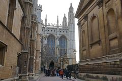 Tourists Visiting King's College Chapel, Cambridge. CAMBRIDGE, UK - DECEMBER 20 2015: A group of Asian tourists exits King's College Chapel during a sightseeing Royalty Free Stock Photos
