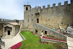 Tourists visiting La Rocca fortless on Borgo Maggiore, San Marin Royalty Free Stock Images