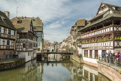 Tourists visiting Little France district in Strasbourg. STRASBOURG, FRANCE - APRIL 03, 2018: Tourists visiting Little France district in Strasbourg, France Royalty Free Stock Photography