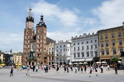 Tourists visiting main market square in front of St. Mary's Basilica, in Krakow, Poland Stock Photos