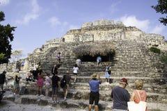 Tourists visiting Mayan ruins at Chacchoben Mexico. Cruise ship tourists visiting the Chacchoben Mayan ruins site. It is a large collection on Mayan pyramid Stock Photo