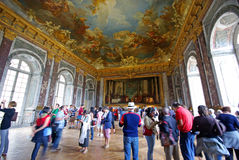 Tourists visiting Mirror's Hall. Versailles Palace, France Royalty Free Stock Image