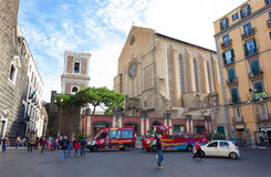 Tourists visiting Naples with the City Sightseeing bus. Royalty Free Stock Photo