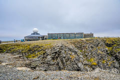 Tourists visiting North Cape Nordkapp located at Finnmark, Norway. Tourists visiting North Cape Nordkapp at midnight in  Finnmark, Norway Royalty Free Stock Photography