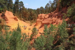 Tourists visiting the ochre rocks near French Roussillon Royalty Free Stock Photography