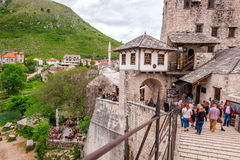 Tourists visiting the Old Bridge in Mostar and historical part of town Stock Photos