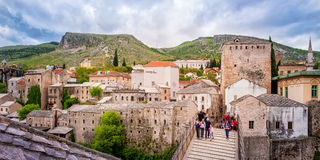 Tourists visiting the Old Bridge in Mostar and historical part of town Royalty Free Stock Image