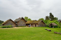 Tourists visiting the old log house in the Pushkin Mikhailovskoe Stock Images