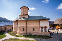 Tourists visiting the old orthodox monastery from Polovragi Stock Photography