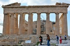Tourists visiting Parthenon in Acropolis Royalty Free Stock Photo