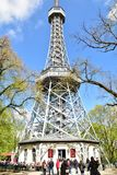 Petrin Hill and Observation Tower in Prague, Europe. Tourists visiting Petrin Hill and Observation Tower in Prague, Europe.The building is a mini version of Stock Photos