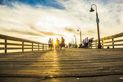 Tourists visiting. A pier full of tourists visiting the san diego bay in a very hot day Royalty Free Stock Image